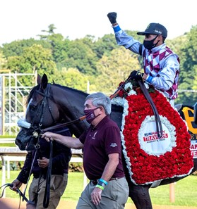 Jack Knowlton, Managing partner of Sackatoga Stables leads Tiz the Law with jockey Manny Franco to the winner's circle after winning the 151st running of The Travers presented by Runhappy at the Saratoga Race Course Saturday Aug.8, 2020 in Saratoga Springs, N.Y.