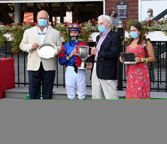Swiss Skydiver with jockey Tyler Gafalione in the irons convincingly wins the 140th running of The Alabama Saturday Aug.15, 2020 at the Saratoga Race Course in Saratoga Springs, N.Y. From left Sherri McPeek, Kenny McPeek, Peter Callahan Photo by Skip Dickstein