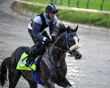 Honor A. P. gallops over a very muddy track at Churchill Downs Thursday Sept. 3, 2020 In Louisville, KY.