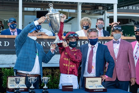Brad Cox, Florent Geroux, and Autry Lowry (far right) after winning the Kentucky Oaks (G1) at Churchill Downs, Louisville, KY on September 4, 2020.