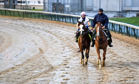 Derby favorite Tiz the Law with exercise rider Heather Smullen get their first look at a very sloppy Churchill  main track Wednesday Sept. 2, 2020 In Louisville, KY.