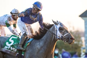 Jockey Luis Saez celebrates a victory from Essential Quality in the Breeders' Cup Juvenile at Keeneland