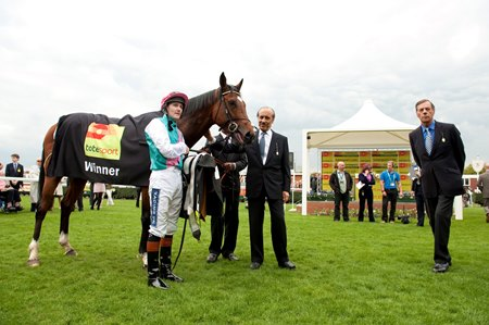 (L-R): Tom Queally, Khalid Abdullah, and Henry Cecil with Frankel after winning the 2011 Greenham Stakes at Newbury Racecourse