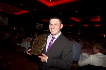 Jockey Rob James accepts the award for champion novice rider in 2014