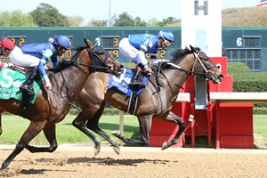 Abrogate (inside) wins the Purple Martin Stakes over Joyful Cadence at Oaklawn Park