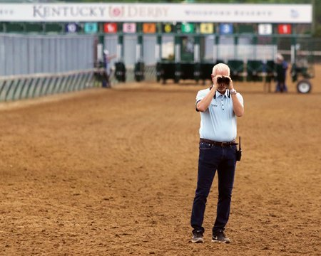 Todd Pletcher keeps an eye on his Kentucky Derby horses April 28 at Churchill Downs