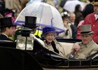 The Queen and The Duke of Edinburgh arrive Prince Philip and HRH Queen Elizabeth II wearing a striking royal blue hat Underneath a large golf umbrella looking cold Royal Ascot at York June 2005