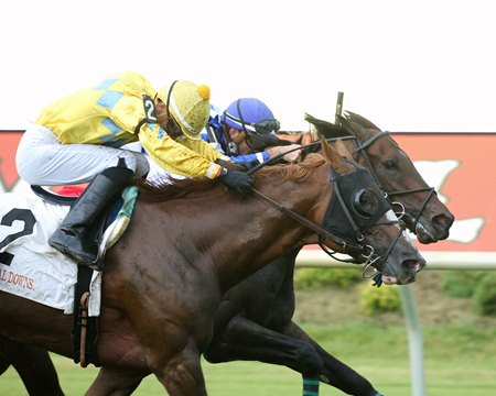 Eons (outside) wins the Buckland Stakes at Colonial Downs